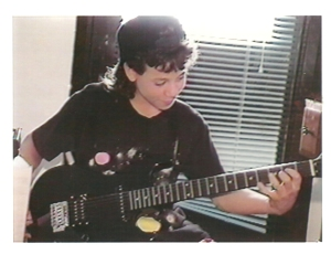 In 1991 playing my Rok Axe electric guitar.