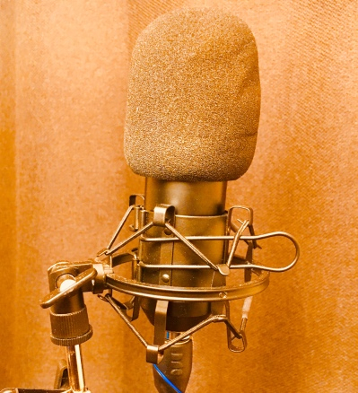 A microphone is a transducer. It converts mechanical energy into electrical energy.